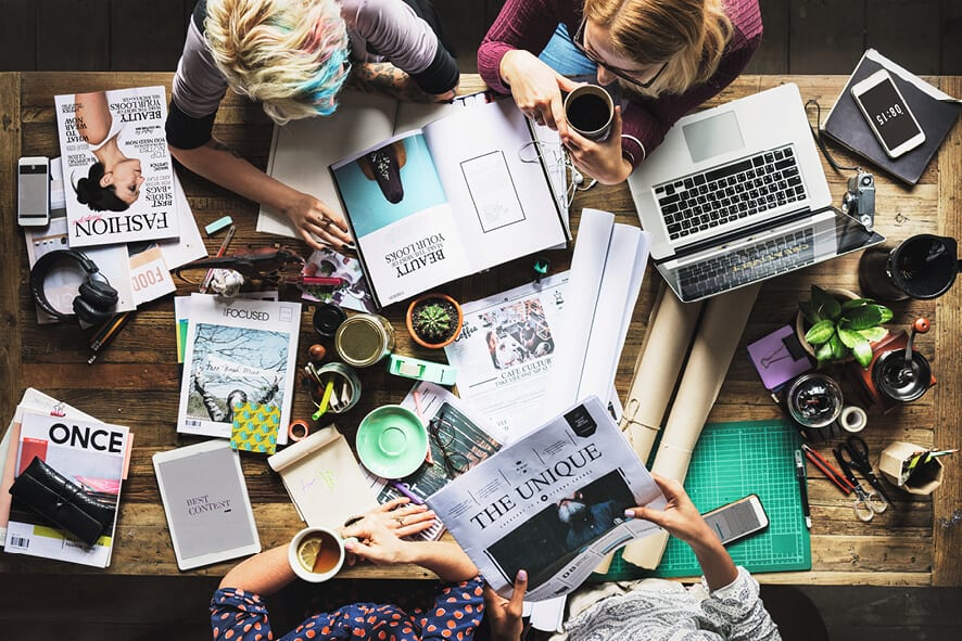 Traditional Print vs Digital Marketing - team brainstorming brochure printing Perth